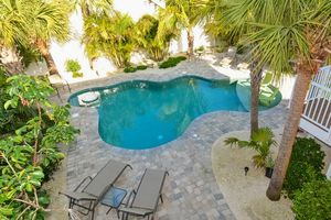 Beautiful pool area with plenty of seating.