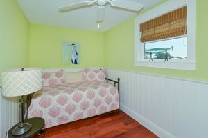 Guest bedroom with day bed and trundle.