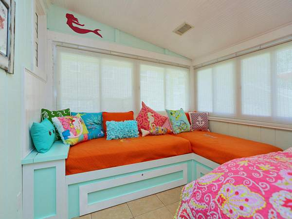 Master bedroom with two twin beds as well