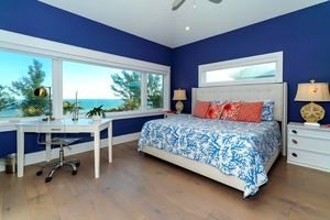 Master bedroom with king bed, flat screen TV and ensuite.