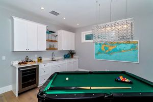 Pool table room with wetbar area.