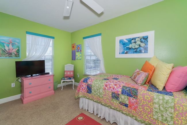 Guest bedroom with large flat screen.