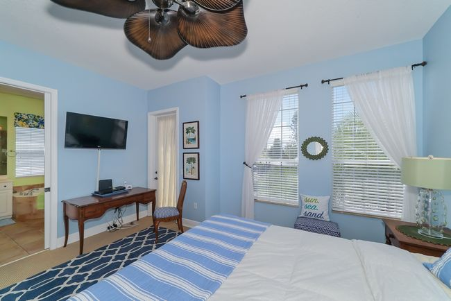Master bedroom with TV.