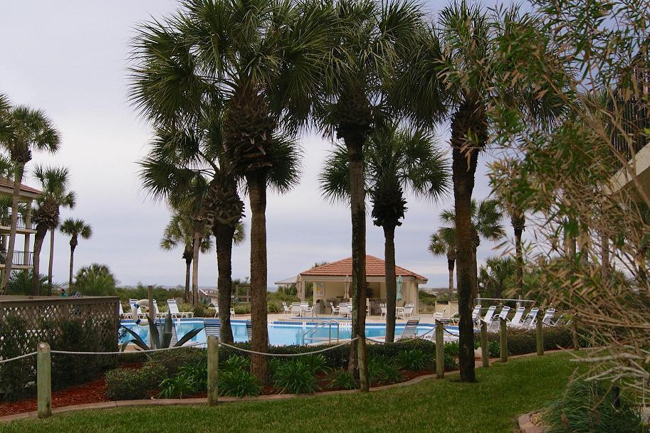 St Augustine Beach condo 1st floor condo with pool and ocean views steps to the beach