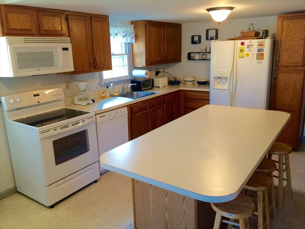 Large Eat-In Kitchen. Refrigerator with Icemaker. D/W. New Electric Stove. Coffeemaker. Toaster Oven.