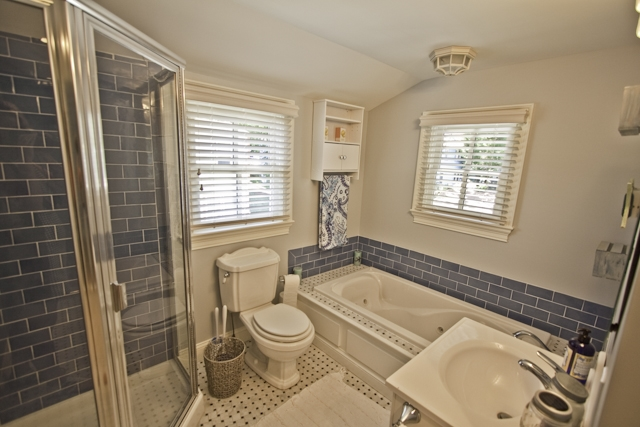 Upstairs bathroom with stand up shower and tub