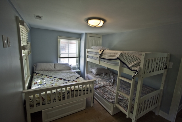 Upstairs bedroom with bunk beds and double