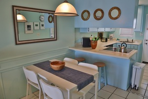 Dining table and chairs with bar seating