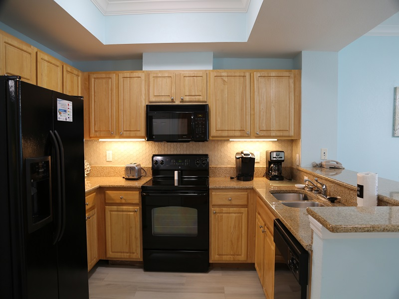 Fully equipped kitchen with modern counters & cabinets