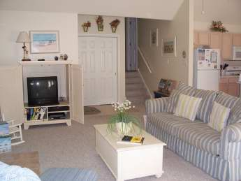 living area and stairs to bedrooms