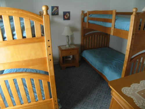Bedroom 2 4 single size beds over and under bunk bed style