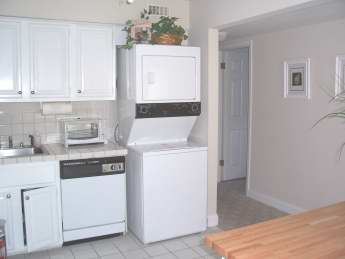 kitchen, washer dryer and hallway to bedrooms