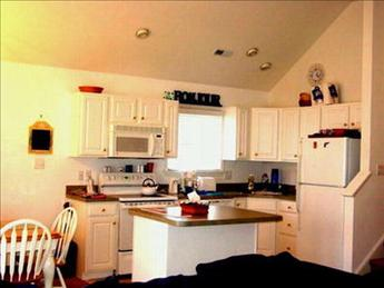 Large kitchen area with island counter