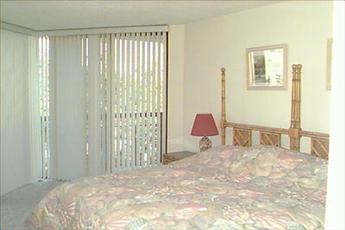 Spacious bedroom has deck entrance also