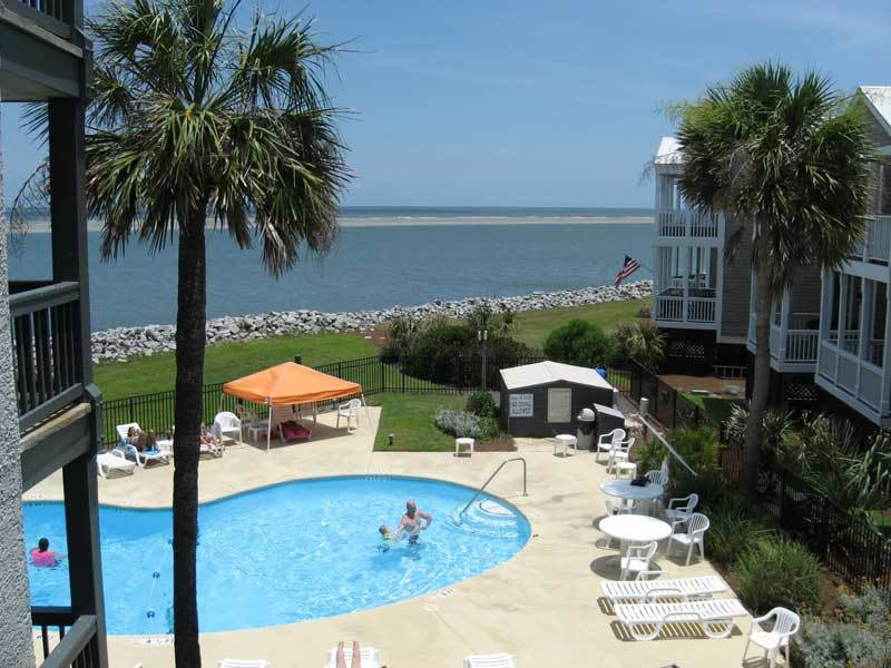 VIEW OF POOL AND OCEAN FROM BALCONY