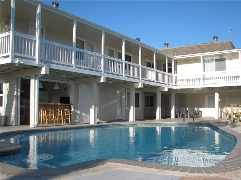Enjoy private jacuzzi and pool with programable lights, and outdoor full kitchen