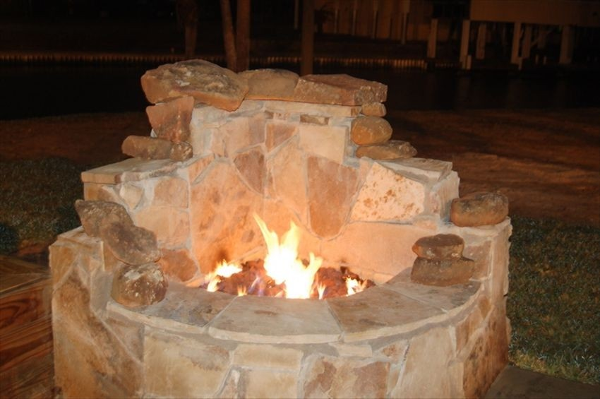 warm up by the outdoor fireplace in the cooler months