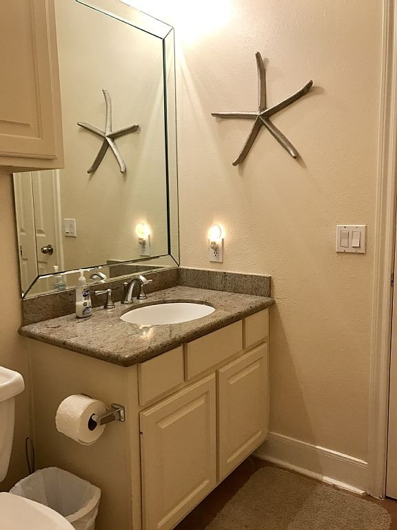 One of the two guest bathrooms which share a tub/shower.