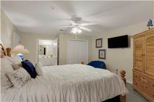 Guest Bedroom with Queen Bed and Flat Screen TV