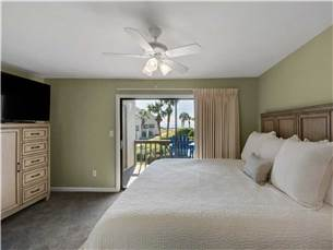 Master Bedroom with Flat Screen TV and Private Balcony