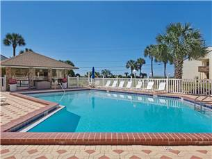 The Beautiful Pool with Lounge Chairs is Right Across from the Beach
