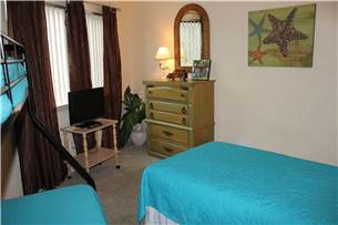 Guest bedroom with flat screen television