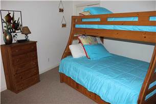 Guest Bedroom with twin top full bottom bunk with twin trundle