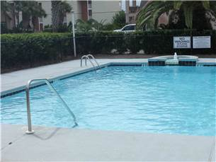 Community Swimming Pool is Located Right Across from the House