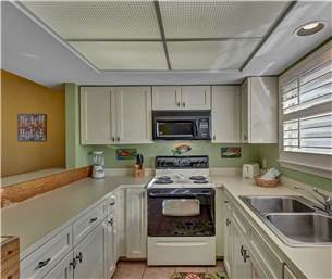 Galley Kitchen with updated cabinetry