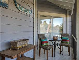 Seating Outside master Bedroom on Screened Porch