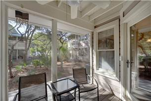 Screened Porch Leading to Large Pool