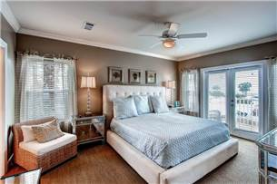 Master bedroom with king bed and balcony access