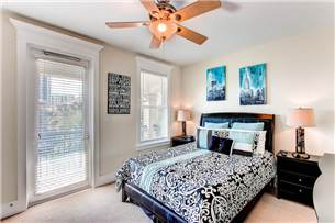 2nd floor guest bedroom with queen size bed and wall mount flat screen TV