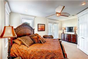 2nd floor master bedroom with king size bed and flat screen TV