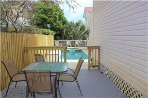 Back yard with pool and privacy fence