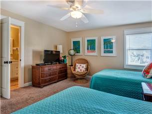 Spacious Guest Bedroom with Flat Screen TV