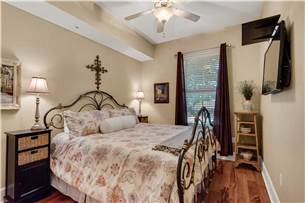 Guest bedroom with king bed and flat screen TV