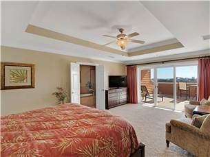Master Bedroom on 2nd Floor with King Bed and Private Balcony