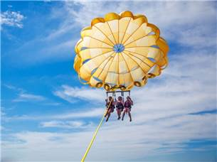 Free adult admission on a Parasailing excursion in season