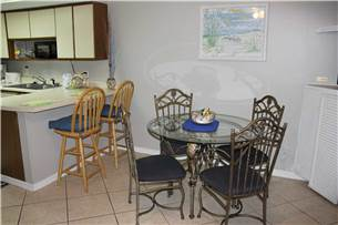 Dining area with additional seating at breakfast bar