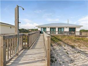 Beachside of Home with Private Boardwalk to private gravel drive which takes you to your beach acces