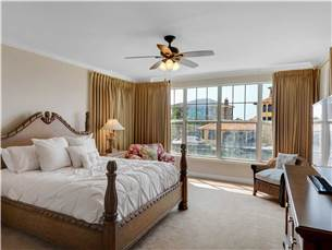 Large master bedroom with balcony access