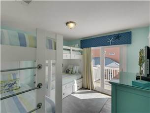 Bunkroom with Flat Screen TV and Balcony Access