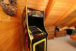 Game area with stand up arcade game.