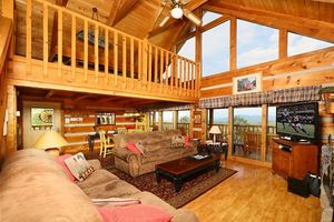 Living area with fire place and flat screen TV.