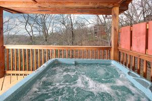 Hot tub on the deck of the cabin.