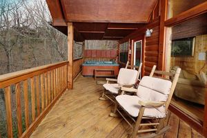 Deck with rockers and hot tub.