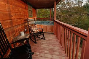 Deck with hot tub and porch rockers