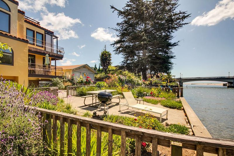 Enjoy The Riverside Picnic Area In Front Of This Beach House