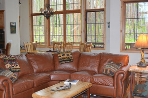 Family room with Dining table in the background.